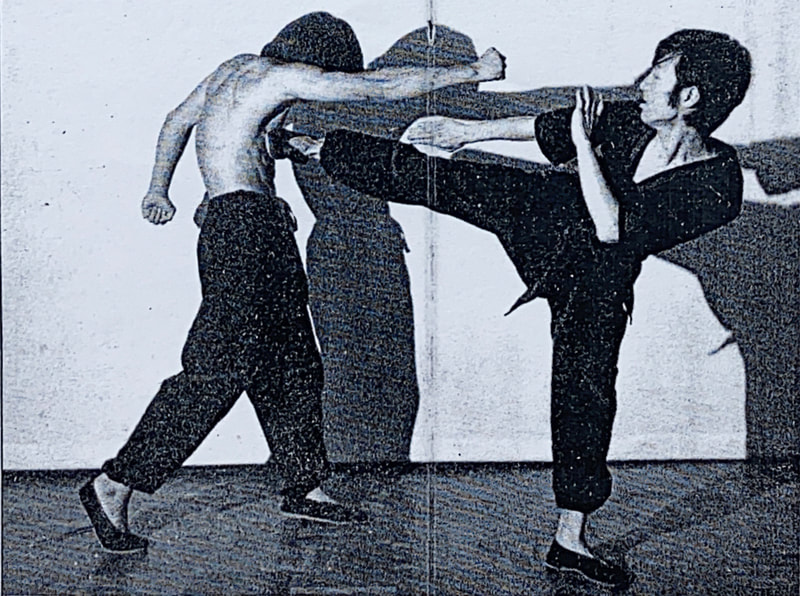 Sifu Elmond Leung, as a young instructor, demonstrates the sidekick for a Wing Tsun publication in Hong Kong.